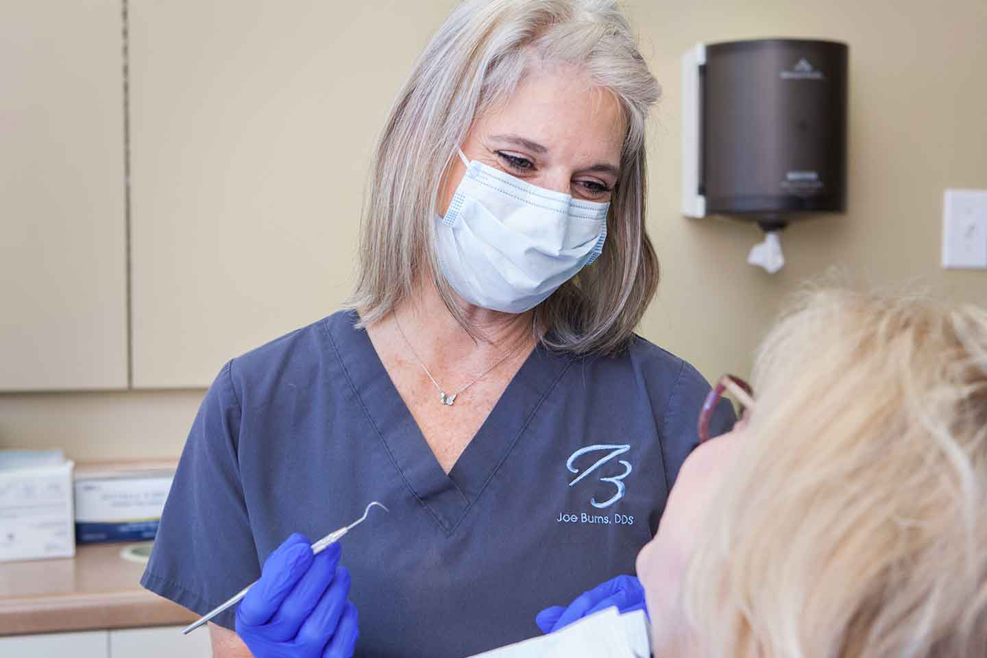 Dental Assistant, Michelle Clark, preparing a patient for dental crowns in Madison, Mississippi